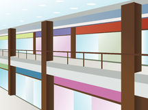 Mall with windows and brown columns Stock Images