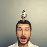 Mall woman screaming at startled man Royalty Free Stock Photo