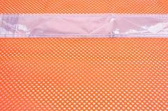 Malla anaranjada de la seguridad con la cinta reflexiva Fotos de archivo