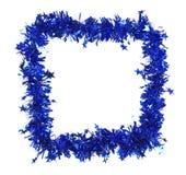 Malla azul de la Navidad con las estrellas como marco. Imagen de archivo libre de regalías
