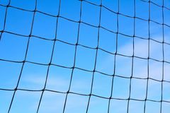 Malla courts. Image of a tennis net with a blue sky background Stock Photo