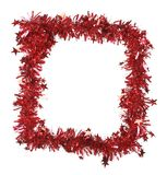 Malla roja de la Navidad como marco. Fotografía de archivo