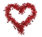 Malla roja de la Navidad con las estrellas como corazón. Fotos de archivo