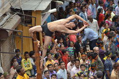 Mallakhamba ( Indian Gymnastics) performance on street. Mallakhamba or Malkhamb is ancient form of Indian Gymnastics, and traditional Indian sport in which a Stock Photos