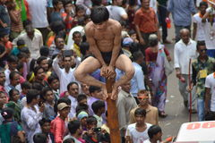 Mallakhamba ( Indian Gymnastics) performance on street. Mallakhamba or Malkhamb is ancient form of Indian Gymnastics, and traditional Indian sport in which a Royalty Free Stock Photo