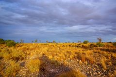 Mallee Desert Stormy Sky. Photograph taken from the Sturt Highway in the Mallee Desert under a rare stormy sky, including the long silhouette of the photographer Royalty Free Stock Photography
