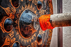 Mallet beating gong in Buddhist temple. Wat Saket, Bangkok, Thailand Royalty Free Stock Images