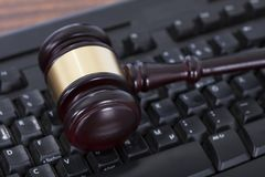 Mallet on computer keyboard. Closeup of mallet on computer keyboard in courtroom Royalty Free Stock Photography