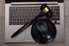 Mallet on computer keyboard. Photo of mallet lying on computer keyboard Royalty Free Stock Images