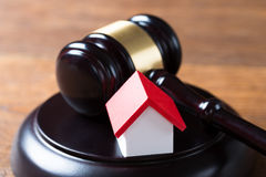 Mallet With House Model On Table In Courtroom Stock Photography