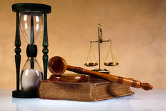 Mallet of judge, legal code and scales.  Stock Photos