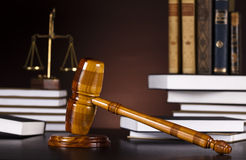 Mallet of judge, legal code and scales. Law theme, mallet of judge, wooden gavel Royalty Free Stock Photo