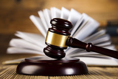 Mallet of judge, legal code and scales. Wooden gavel and books, ambient light vivid theme Stock Photography