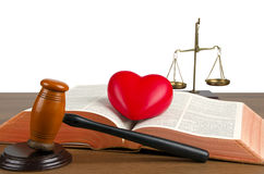 Mallet, legal code, heart and scales of justice. Law concept, studio shots Stock Photos