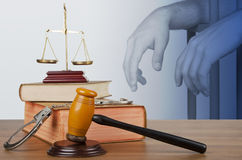 Mallet, legal code and scales of justice. On background with prisoner Royalty Free Stock Photos