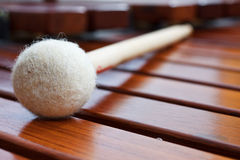 Mallet on marimba. Close-up of a mallet on a wooden marimba royalty free stock photography