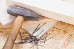 Mallet with nails and planks of new wood. Of varying thicknesses in a carpentry, joinery , DIY and building concept Royalty Free Stock Image