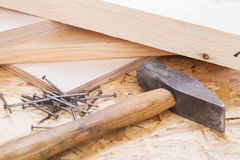 Mallet with nails and planks of new wood Stock Photography