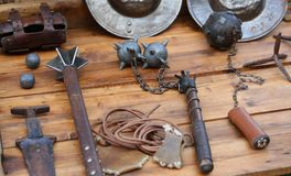Mallet and other medieval weapons during the reenactment. Of middle ages Stock Image