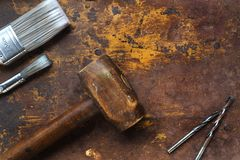 Mallet and paint brushes on textured surface Royalty Free Stock Photo