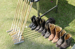 Mallet and shoes. For polo Stock Photos