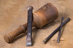 Mallet with three chisels. A mallet with three chisels royalty free stock photo