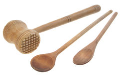Mallet and two wooden spoons. On white Stock Image
