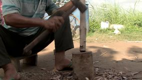 Mallet, wood,  cambodia, southeast asia stock video