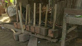 Mallet, wood, homemade, cambodia, southeast asia stock footage