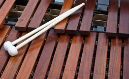 Mallets on marimba. Close-up of a pair of mallets on a wooden marimba Stock Image