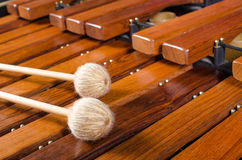 Mallets on marimba, close up. Full frame take of two mallets resting on the keys of a marimba Royalty Free Stock Images