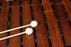 Mallets on marimba. Full frame take of two mallets resting on the keys of a marimba Stock Images