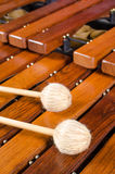 Mallets on marimba full frame. Full frame take of two mallets resting on the keys of a marimba Stock Image