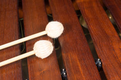 Mallets on marimba, percussion instrument. Full frame take of two mallets resting on the keys of a marimba Royalty Free Stock Images