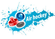 Mallets and puck for air hockey game Royalty Free Stock Photography
