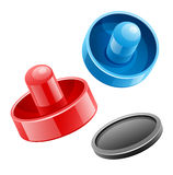 Mallets and puck for playing air hockey game Royalty Free Stock Photography