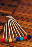Mallets resting on marimba. Coloured marimba mallets resting on a marimba Royalty Free Stock Image