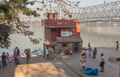 Mallick ghat on the banks of the river Hooghly with the famous Howrah bridge at the backdrop. Royalty Free Stock Photo