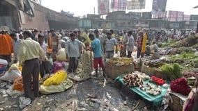 Mallik Ghat flower market in Kolkata, West Bengal, India. KOLKATA, WEST BENGAL / INDIA - FEBRUARY 13TH : Busy , crowded and colorful Mallik Ghat flower market in stock video