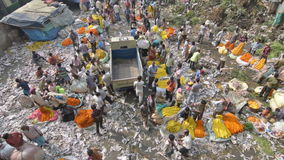 Mallik Ghat flower market in Kolkata, West Bengal, India. KOLKATA, WEST BENGAL / INDIA - FEBRUARY 13TH : Top view of busy ,crowded and colorful Mallik Ghat stock footage
