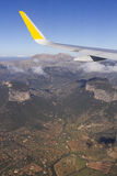 Mallorca. Aerial landscape. Wing of a commercial airplan flying over the island of Mallorca. Spain Royalty Free Stock Photos