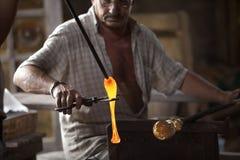 Mallorca. Algaida Es Pla, Majorca / Spain - August 25, 2016: A man working with the molten glass at handmade glass manufacturing factory Guardiola, Algaida Es royalty free stock photo