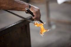 Mallorca. Algaida Es Pla, Majorca / Spain - August 25, 2016: A man working with the molten glass at handmade glass manufacturing factory Guardiola, Algaida Es stock images