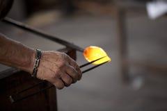 Mallorca. Algaida Es Pla, Majorca / Spain - August 25, 2016: A man working with the molten glass at handmade glass manufacturing factory Guardiola, Algaida Es royalty free stock photos