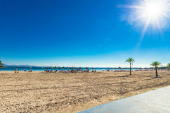 Mallorca beach of Alcudia bay, Spain Mediterranean Sea. Sandy beach with palm trees Platja d`Alcudia on Majorca island, Spain Mediterranean Sea, Balearic Stock Photo