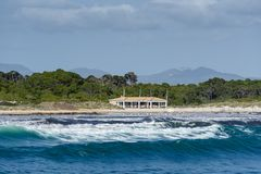 Mallorca beach with big sea waves. Landscape. Surf station on the beach Stock Photos