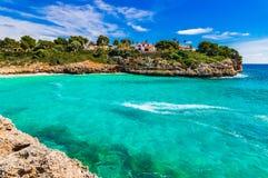 Beautiful seaside with turquoise blue sea water on Majorca island, Spain. Mallorca beach of Cala Anguila, idyllic bay seaside, Spain Balearic islands Stock Photos