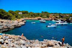Mallorca beach. MALLORCA, SPAIN - AUGUST 1, 2015: sandy beach with people sunbathing and playing on a sunny summer day on August 1, 2015 in Mallorca, Balearic Royalty Free Stock Image