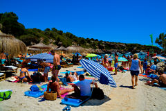 Mallorca beach. MALLORCA, SPAIN - AUGUST 1, 2015: sandy beach with people sunbathing and playing on a sunny summer day on August 1, 2015 in Mallorca, Balearic Royalty Free Stock Images