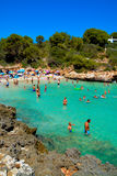 Mallorca beach. MALLORCA, SPAIN - AUGUST 1, 2015: sandy beach with people sunbathing and playing on a sunny summer day on August 1, 2015 in Mallorca, Balearic Stock Photography